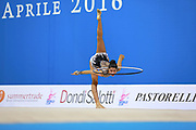"""Agiurgiuculese Alexandra during hoop routine at the International Tournament of rhythmic gymnastics """"Città di Pesaro"""", 03 April,2016. Alexandra is an Italian individualistic gymnast, of Romanian origins, born in Lasi, 15 January, 2001.<br /> This tournament dedicated to the youngest athletes is at the same time of the World Cup.."""