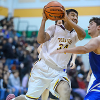 Tohatchi Cougar Brennen Chee (34) charges into Zuni Thunderbird Xavier Benevidez (25) Thursday at Wingate High School.