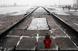 A candle sits at the end of the train tracks ahead of a memorial ceremony at Birkenau to mark International Holocaust Memorial Day on the anniversary of the liberation of Auschwitz.