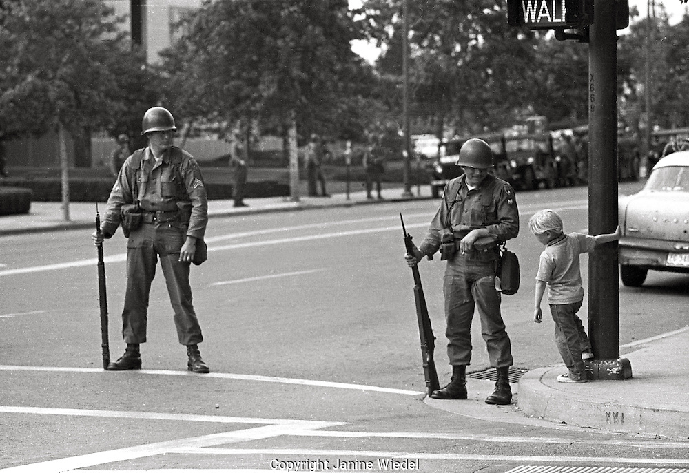 National guard soldiers talking with young child during  People's Park  Student protest & riots in Berkeley California 1969