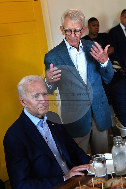 Former Charleston Mayor Joe Riley, right, introduces Democratic presidential hopeful former Vice President Joe Biden during a lunch with local officials at the Butcher and Bee July 7, 2019 in Charleston, South Carolina. Riley, mayor of the city for 42-years has endorsed the former Vice President.