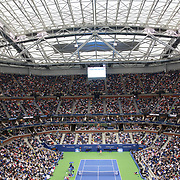 2017 U.S. Open Tennis Tournament - DAY TWO. A general view under the closed roof of Arthur Ashe Stadium showing Rafael Nadalof Spain in action against DusanLajovic of Serbia during the Men's Singles round one match at the US Open Tennis Tournament at the USTA Billie Jean King National Tennis Center on August 29, 2017 in Flushing, Queens, New York City.  (Photo by Tim Clayton/Corbis via Getty Images)