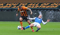 Ryan Broom of Peterborough United tackles Josh Magennis of Hull City - Mandatory by-line: Joe Dent/JMP - 24/10/2020 - FOOTBALL - KCOM Stadium - Hull, England - Hull City v Peterborough United - Sky Bet Championship