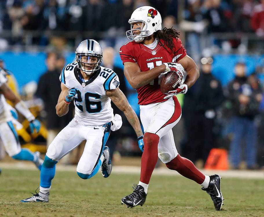 CHARLOTTE, NC - JAN 24:  Wide receiver Larry Fitzgerald #11 of the Arizona Cardinals runs after a catch and is pursued by cornerback Cortland Finnegan #26 of the Carolina Panthers during the NFC Championship game at Bank of America Stadium on January 24, 2016 in Charlotte, North Carolina.