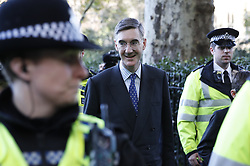 CAPTION CORRECTION TO SPELLING OF JACOB REES MOGG © Licensed to London News Pictures. 19/10/2019. London, UK. Jacob Rees Mogg leaves Parliament surrounded by police after MPs voted for a Brexit deal delay. The Prime Minister's new Brexit deal is being debated and voted on in an historic Saturday sitting in The House of commons today. Photo credit: Peter Macdiarmid/LNP