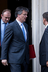 © Licensed to London News Pictures. 05/09/2012. LONDON, UK. Michael Moore, the Scottish Secretary, is seen leaving Number 10 Downing Street in London today (05/09/12) after attending the first cabinet meeting after a cabinet reshuffle that took place yesterday (04/09/12).  Photo credit: Matt Cetti-Roberts/LNP