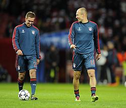 Bayern Munich's Philipp Lahm (left) and Bayern Munich's Arjen Robben (right) - Photo mandatory by-line: Joe Meredith/JMP - Tel: Mobile: 07966 386802 19/02/2014 - SPORT - FOOTBALL - London - Emirates Stadium - Arsenal v Bayern Munich - Champions League - Last 16 - First Leg