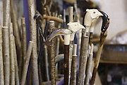 Hand-carved walking sticks made by Keith Pickering are sitting in his shop in Helmsley, Yorkshire, England, United Kingdom.