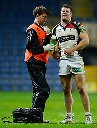 Harlequins Number 8 (#8) Nick Easter whinces in pain as a team physio attends him during the second half of the match - Photo mandatory by-line: Rogan Thomson/JMP - Tel: Mobile: 07966 386802 06/01/2013 - SPORT - RUGBY - Kassam Stadium - Oxford. London Welsh v Harlequins - Aviva Premiership.