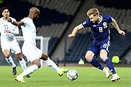 Scotland midfielder Stuart Armstrong (8) (Southampton)   and Eli Dasa (2) (Maccabi Tel Aviv)of Israel during the UEFA Nations League match between Scotland and Israel at Hampden Park, Glasgow, United Kingdom on 20 November 2018.