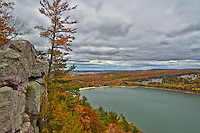 Devil's Lake is a small lake in Baraboo, Wisconsin that it is surrounded on both sides by 500 foot high bluffs. The trails in this state park provide some of the most beautiful views in the state. Even though it was cloudy, the fall colors were amazing on this day in early October. This view is from the west bluff looking to the north end of the lake.