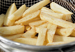 Embargoed to 1600 Tuesday November 20 File photo dated 29/08/14 of homemade chips, rich in carbohydrates being cooked in a household fat fryer. Consuming less protein and more carbohydrates could be the key to long life and healthy brain ageing, a new study suggests. Scientists at the University of Sydney in Australia came to the conclusion after conducting diet experiments on mice.