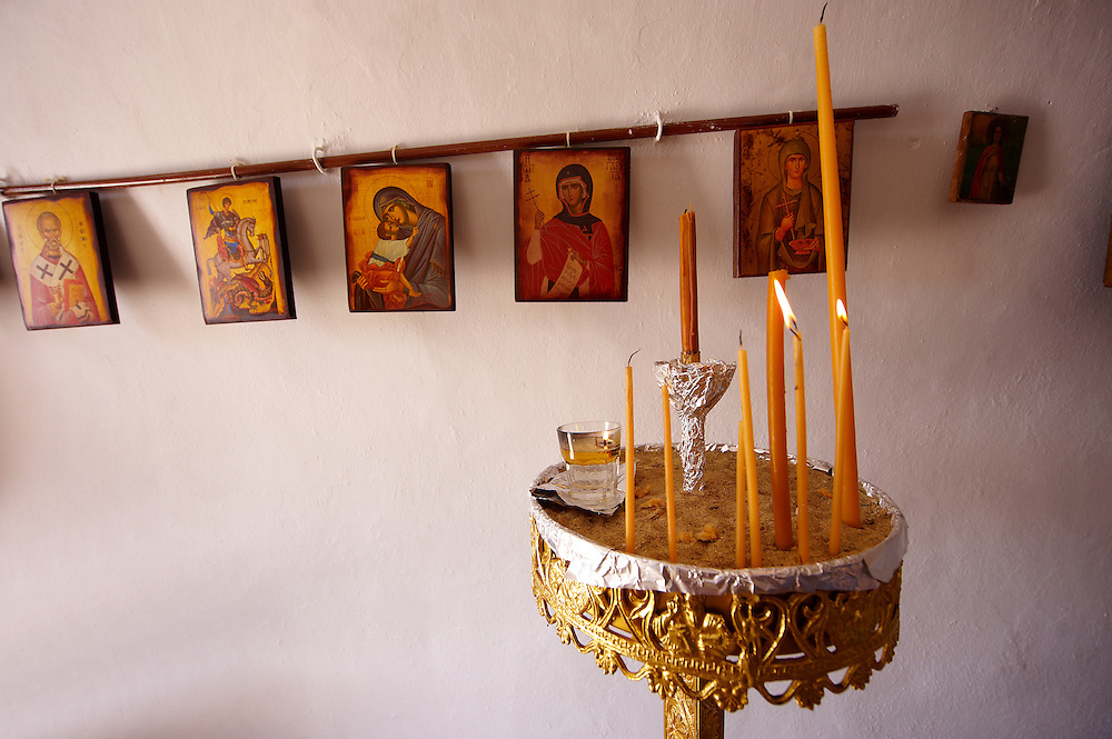 Interior of one of the 365  Greek Orthodox Chapels of Ios with religious icons. Cyclades Islands, Greece .<br /> <br /> Visit our GREEK HISTORIC PLACES PHOTO COLLECTIONS for more photos to download or buy as wall art prints https://funkystock.photoshelter.com/gallery-collection/Pictures-Images-of-Greece-Photos-of-Greek-Historic-Landmark-Sites/C0000w6e8OkknEb8