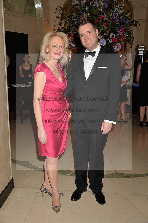MATTHEW CUNNINGHAM and IDA LEVINE at a dinner hosted by the Royal Academy of Dance to present the Queen Elizabeth II Award 2014 held at Claridge's, Brook Street, London on 4th September 2014.