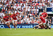 Wales' Jamie Roberts off loads the ball to Rhys Priestland  as he is hit by England's Courtney Laws during the The Old Mutual Wealth Cup match England -V- Wales at Twickenham Stadium, London, Greater London, England on Sunday, May 29, 2016. (Steve Flynn/Image of Sport)