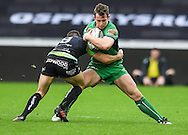 Connacht's Matt Healy is tackled by Ospreys' Tom Habberfield.<br /> <br /> Guinness Pro12 rugby match, Ospreys v Connacht rugby at the Liberty Stadium in Swansea, South Wales on Saturday 7th January 2017.<br /> pic by Craig Thomas, Andrew Orchard sports photography.