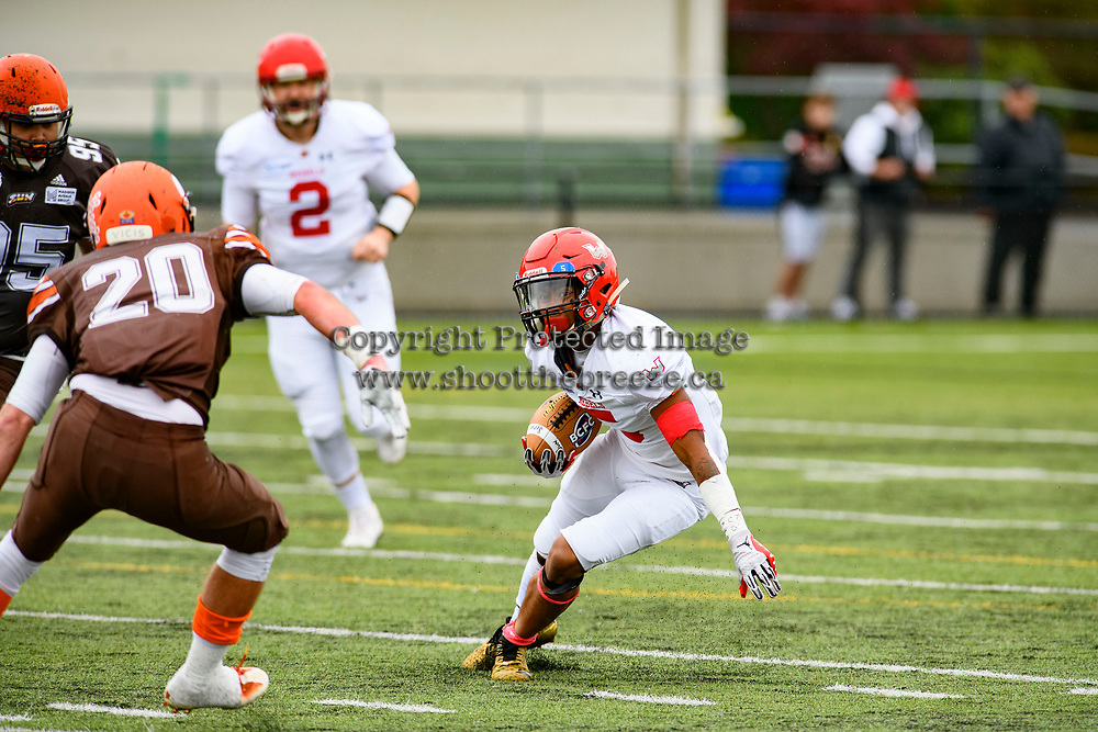CHILLIWACK, BC - SEPTEMBER 11: Broxx Comia #5 of Westshore Rebels looks for an opening to run with the ball during the first quarter against the Okanagan Sun at Exhibition Stadium in Chilliwack, BC, Canada. (Photo by Marissa Baecker/Shoot the Breeze)