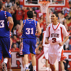 Jan 31, 2009; Piscataway, NJ, USA; Rutgers guard Mike Rosario (3) smiles after teammate forward Jaron Griffin (32) scored a three point basket to seal Rutgers' 75-56 victory over DePaul in NCAA college basketball at the Louis Brown Athletic Center