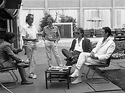 "Sade and Tony Hadley Interviews.  P92..1984.21.08.1984..08.21.1984..21st August 1984..As part of his interview sessions for ""Video File"" for R.T.E., Marty Whelan interviewed international music stars. The interviews were held in the R.T.E.,studios and at various hotels throughout the city...Image shows Marty Whelan (L) setting up the interview with Tony Hadley and Gary Kemp of the pop group 'Spandau Ballet'. Spandau Ballet were to the forefront of the 'New Romantic' pop movement."