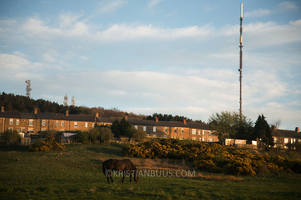 Sunset in Dipton, Pont Valley, County Durham 4 May 2018. Sunset in Pont Valley ahead of the the day of protest against the mining company Banks outside Dipton in Pont Valley, County Durham, 4 May 2018. Locals have fought the open cast coal mine for thirty years and three times the local council rejected planning permissions but central government has overruled that decision and the company Banks was granted the license and rights to extract coal in early 2018. Locals have teamed up with climate campaigners and together they try to prevent the mining from going ahead. The mining will have huge implications on the local environment and further coal extraction runs agains the Paris climate agreement. A rare species of crested newt live on the land planned for mining and protectors are trying to stop the mine to save the newt.