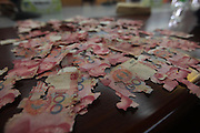 FOSHAN, CHINA - JUNE 05: (CHINA OUT)<br /> <br /> Cash Eaten By Termites In Foshan, China<br /> <br /> Staff deal with damaged Chinese 100 yuan bank notes at a branch of The People's Bank of China on June 5, 2013 in Foshan, Guangdong Province of China. A 60-year-old woman hid more than 400,000 yuan (about 65,000 USD) at home half a year ago. She recently found that her money was eaten by termites. The bank can help exchange 383,850 damaged notes for new ones. The woman lost nearly 60,000 yuan. <br /> ©Exclusivepix