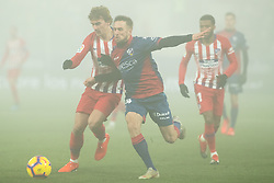 January 19, 2019 - Huesca, Aragon, Spain - Griezmann of Atletico de Madrid (7) competes for the ball with Miramon of SD Huesca (24)during the Spanish League football match between SD Huesca andClub Atletico de Madrid at the El Alcoraz stadium in Madrid on January 19, 2019. Atletico wins 0-3. (Credit Image: © Daniel Marzo/Pacific Press via ZUMA Wire)