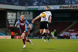 Derrick Williams of Bristol City is challenged by Paddy Madden of Scunthorpe United - Photo mandatory by-line: Rogan Thomson/JMP - 07966 386802 - 17/01/2015 - SPORT - FOOTBALL - Scunthorpe, England - Glanford Park - Scunthorpe United v Bristol City - Sky Bet League 1.