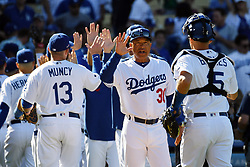 March 28, 2019 - Los Angeles, California, U.S. - Dodger Manager Dave Roberts congratulates his team after defeating the Diamondbacks on opening day at Dodger Stadium, Thursday, March 27, 2019. Te Dodgers beat the Diamondbacks 12-5. (Credit Image: © Hans Gutknecht/SCNG via ZUMA Wire)