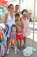 Brooklyn, New York, USA. 10th August 2013. The smiling family is showing off their faces painted by volunteer artist Laura Yorburg, of Yorktown Heights, during the 3rd Annual Coney Island History Day celebration.