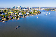 Aerial view of houses along the Brisbane River in the suburb of Bulimba, Brisbane, Queensland, Australia