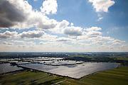 Nederland, Zuid-Holland, Gemeente Reeuwijk, 15-07-2012; Reeuwijksche Plassen (Reeuwijkse Plassen). De veenplassen zijn ontstaan door het afgraven en wegbaggeren van het veen voor het winnen van turf. Uitzondering is de plas in de voorgrond, dit is een zandwinplas ontstaan door het winnen van zand, nodig voor de aanleg van de A12..Recreation area and peat lakes Reeuwijksche Plassen are created by peat and sand extraction. .luchtfoto (toeslag), aerial photo (additional fee required).foto/photo Siebe Swart