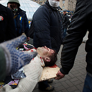 KIEV, UKRAINE - February 20, 2014: Anti-government protestors advance on police lines in the early hours of the day. The riot police responded with sniper fire causing at least 25 casualties with shots to the head. CREDIT: Paulo Nunes dos Santos