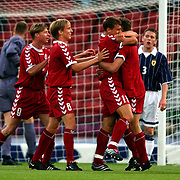 Denmark's Ebbe Sand (no 11) is congratulated on scoring by teammates Dennis Rommedahl (r) and Jon Dahl Tomasson (l) and Christian Poulsen (no 6)