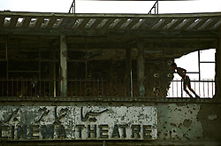 Afghan athletes playing gym in the old cinema of Kabul