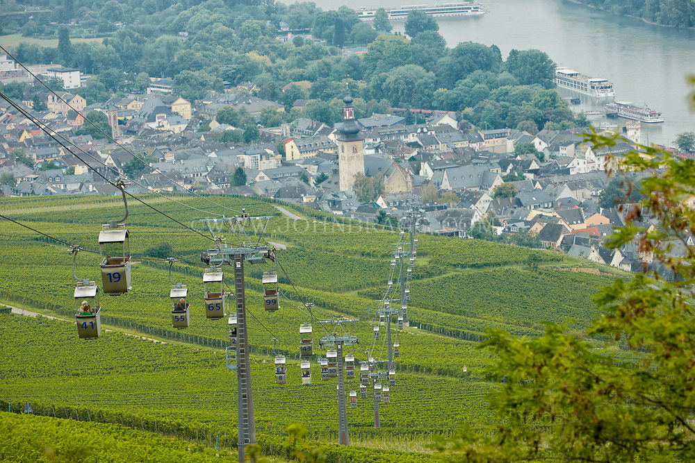 View of cable cars, vineyards, St. Jakobus Church, Market Square, and the Rhein, Rüdesheim, Germany.