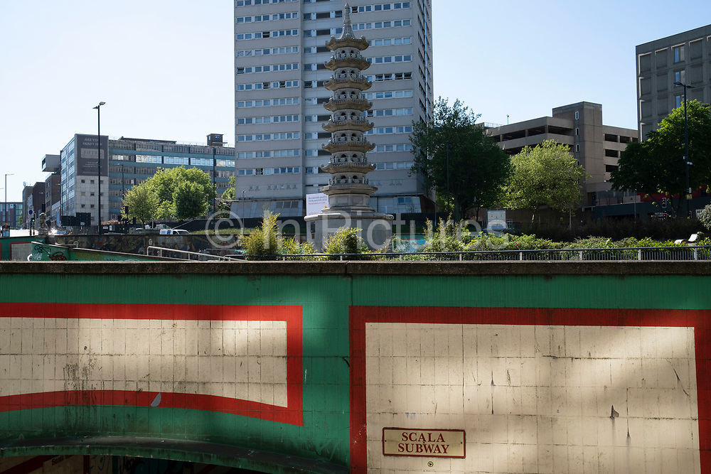 Holloway Circus, where new buildings juxtapose the old pagoda in the city centre of Birmingham virtually deserted under Coronavirus lockdown on 20th May 2020 in Birmingham, England, United Kingdom. This area is a maze of underpasses and pedestrian subways linking various main roads in the city centre. Coronavirus or Covid-19 is a new respiratory illness that has not previously been seen in humans. While much or Europe has been placed into lockdown, the UK government has put in place more stringent rules as part of their long term strategy, and in particular social distancing.