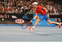 © Licensed to London News Pictures. 21/01/2012. Melbourne Park, Australia. Andy Murray (GBR) stride out to reach the ball in his men's singles match against Michael Llodra (FRA) during the 6th day, round 3 of the Australian Open. Photo credit : Asanka Brendon Ratnayake/LNP