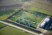 Nederland, Gelderland, Zaltbommel, 11-02-2008; trafostation, onderdeel van het landelijk elektriciteitsnet; na dit onderstation gaat de stroom met verlaagde spanning door middel van kabels ondergronds verder (distributienet); distributie, netwerk, koppelnet, trafo..luchtfoto (toeslag); aerial photo (additional fee required); .foto Siebe Swart / photo Siebe Swart