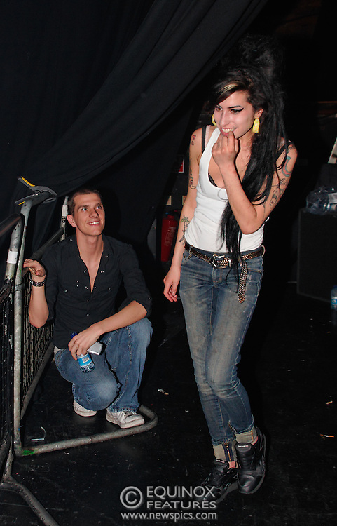 Singer Amy Winehouse, DOB=14/09/1983, performing for her gay fans at the G-A-Y Club. G-A-Y is London's biggest gay club and is held at the London Astoria nightclub, Soho, London, UK. Amy spent much of the show rubbing her itchy nose. She also seemed to have signs of old scars all down one arm...Picture Data:.Photographer: Edward Hirst.Copyright: ©2007 Licensed to Equinox News Pictures +448700 780000.Contact: Equinox Features.Date Taken: 20070415.Time Taken: 014057+0000.www.newspics.com