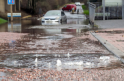 Storm Ciara, 9 February 2020<br /> <br /> Pictured: A car is abandoned after becoming stuck in flood waters in Livingston, West Lothian. Water could be seen bubbling up from a nearby storm drain.<br /> <br /> Alex Todd | Edinburgh Elite media