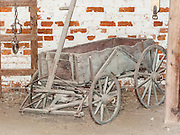1700s style wagon. Mount Vernon, Virginia, was the plantation home of George Washington, the first President of the United States (1789-1797). The mansion is built of wood in neoclassical Georgian architectural style on the banks of the Potomac River. Mount Vernon estate was designated a National Historic Landmark in 1960 and is owned and maintained in trust by The Mount Vernon Ladies' Association. The estate served as neutral ground for both sides during the American Civil War, although fighting raged across the nearby countryside. George Washington, who lived 1732-1799, was one of the Founding Fathers of the United States of America (USA), serving as the commander-in-chief of the Continental Army during the American Revolutionary War, and presiding over the convention that drafted the Constitution in 1787. Named in his honor are Washington, D.C. (the District of Columbia, capital of the United States) and the State of Washington on the Pacific Coast.