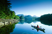 Alaska, Tongass National Forest, West Chichagof-Yakobi Wilderness, Yakobi Island. Woman in kayak.