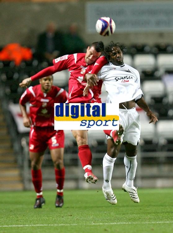 Photo: James Davies.<br />Swansea City v Swindon Town. Coca Cola League 1. 02/10/2007. <br />Swindon`s Lee Peacock tries to win ball against Jason Scotland.