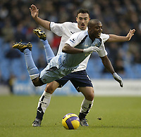 Photo: Aidan Ellis.<br /> Manchester City v Tottenham Hotspur. The Barclays Premiership. 17/12/2006.<br /> City's Hatem Trabelsi is brought down by Spurs Steed Malbranque