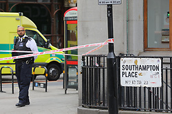 © Licensed to London News Pictures. 15/08/2018. London, UK. Police close the road at the scene of an accident at Holborn where a cyclist has died after being hit by a lorry - believed to be former doctor to the Queen Peter Fisher. Photo credit: Rob Pinney/LNP