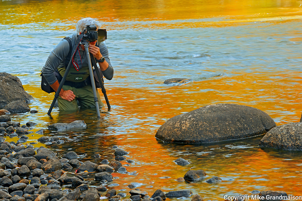 Photographer Mike Karakas hard at work in Dryberry Creek<br />Sioux Narrows<br />Ontario<br />Canada