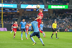 September 26, 2018 - Bronx, New York, US - Chicago Fire midfielder DJORDJE MIHAILOVIC (14) jumps to head the ball over New York City FC forward DAVID VILLA (7) during a regular season match at Yankee Stadium in Bronx, New York.  New York City FC defeats Chicago Fire 2 to 0 (Credit Image: © Mark Smith/ZUMA Wire)