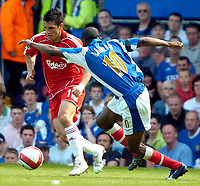Photo: Ed Godden.<br /> Portsmouth v Liverpool. The Barclays Premiership. 28/04/2007. Liverpool's Mark Gonzalez (L) is confronted by Lauren.