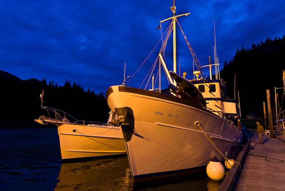 View of the Ursa Major docked at Baranof Warm Springs at twilight, Baranof Island, Southeast Alaska