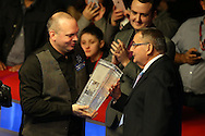 Stuart Bingham of England is presented with the new Ray Reardon trophy by Welsh snooker legend Ray Reardon (r) after winning the match. Coral Welsh Open Snooker 2017, final match, Judd Trump of England v Stuart Bingham of England at the Motorpoint Arena in Cardiff, South Wales on Sunday 19th February 2017.<br /> pic by Andrew Orchard, Andrew Orchard sports photography.